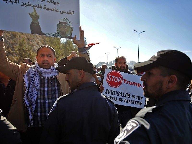 Palestinian protesters demonstrate against Trump and the construction of Jewish settlements in the occupied West Bank, near the Jewish settlement of Maale Adumim, east of Jerusalem, on Friday.
