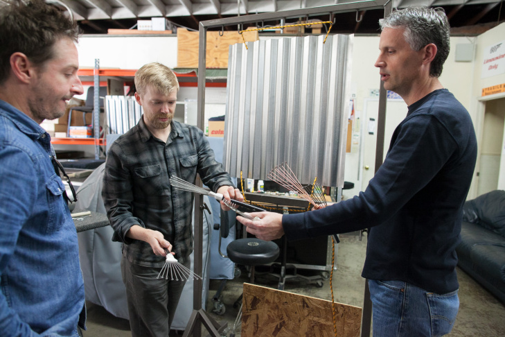 Composer Andrew Norman, left, and L.A. Chamber Orchestra percussionist Wade Culbreath consider possible instruments for the performance of