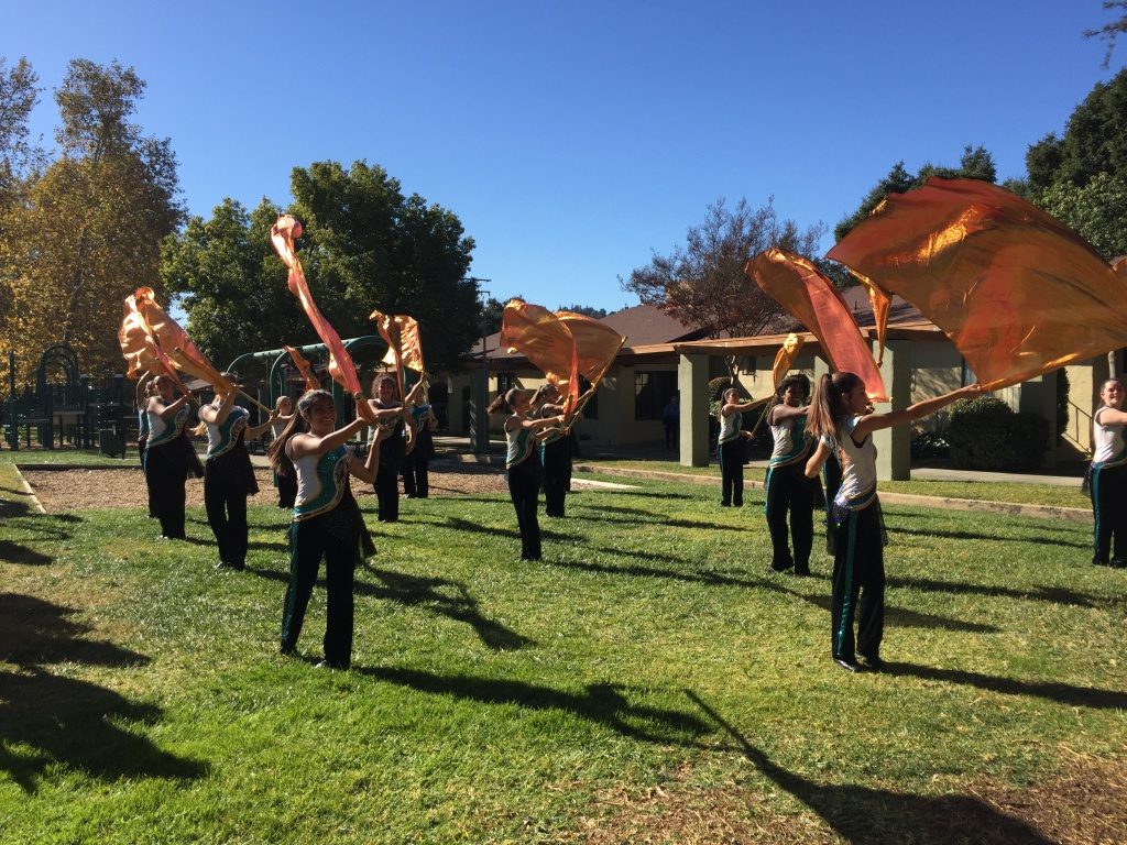 The Band of Santiago Sharks Color Guard performs at Five Acres, a children & family services agency in Altadena.