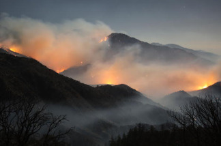 The 241-square-mile Station Fire blackens forests and races up rugged canyons along its eastern front deep in the Angeles National Forest on September 4, 2009 northeast of Pasadena, California. The blaze is the biggest wildfire in Los Angeles County history. Officials believe it was started by an arsonist along Angeles Crest Highway near La Canada, California. If caught, the suspect could be charged with first-degree murder for the deaths of two firefighters whose truck rolled down an 800-foot mountainside as they retreated from flames.