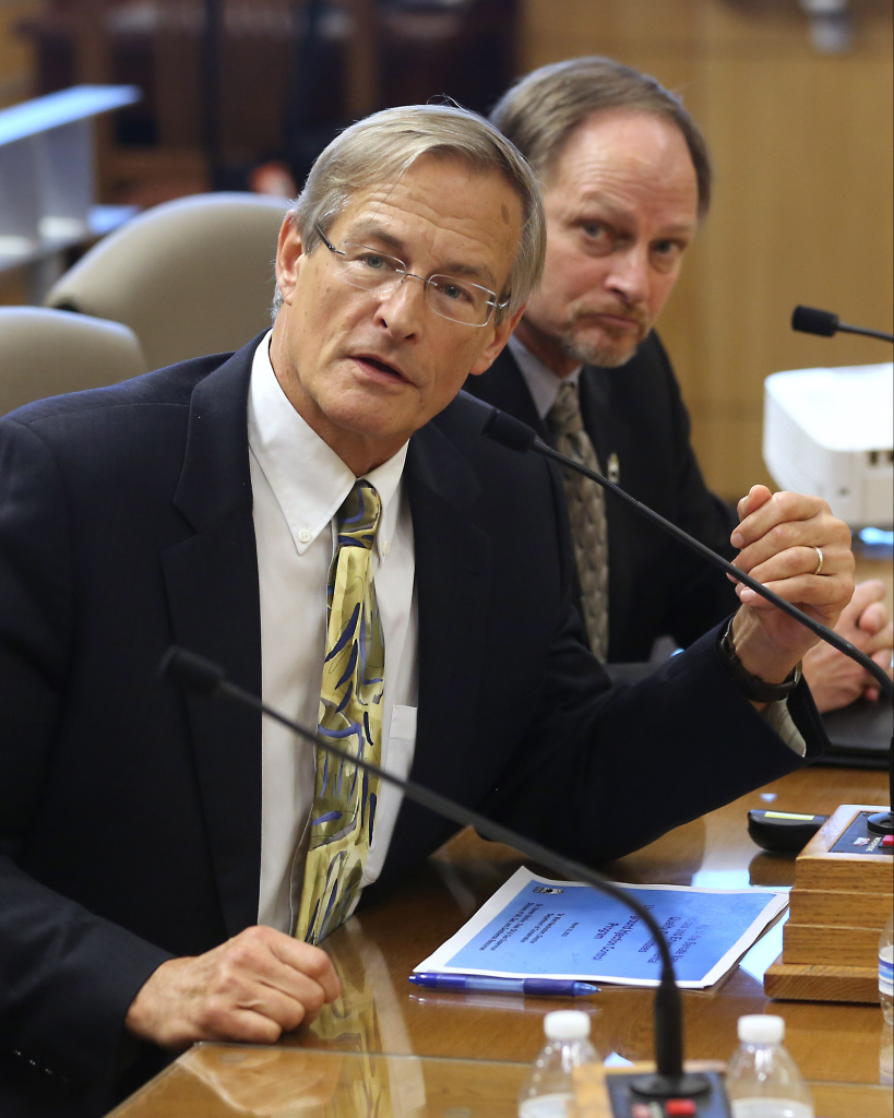 In this file photo from March 10, 2015, Steven Bohlen, left, then Gas Supervisor for the Conservation Departments Division of Oil, Gas and Geothermal Resources answers a question during a joint hearing of the Senate Natural Resources and Water and Environmental Quality Committees at the Capitol in Sacramento, Calif.
