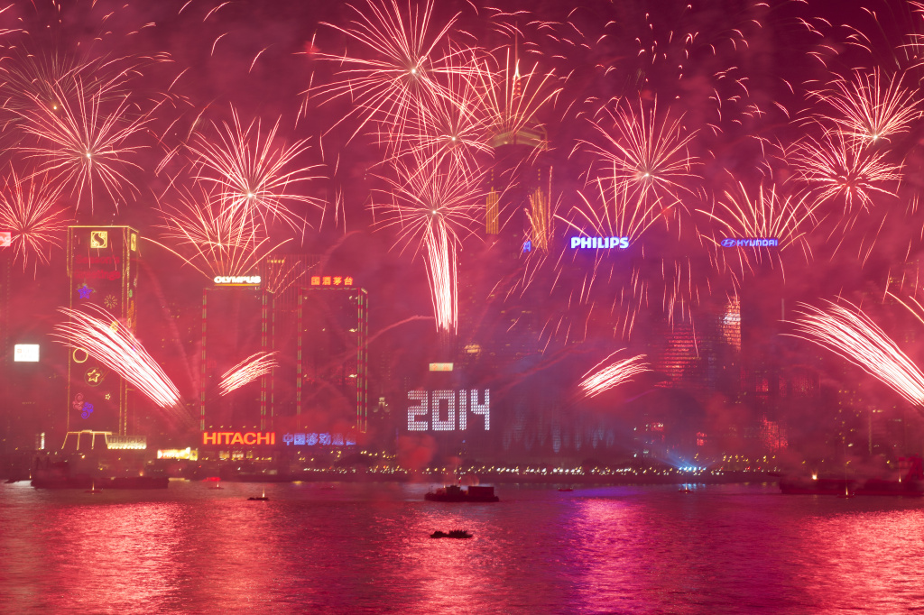 Fireworks explode over Victoria Harbour in Hong Kong on Jan. 1, 2014. A wave of pyrotechnic displays kicked off new year celebrations in major cities around the world, with Hong Kong welcoming 2014 with a choreographed music and fireworks show.