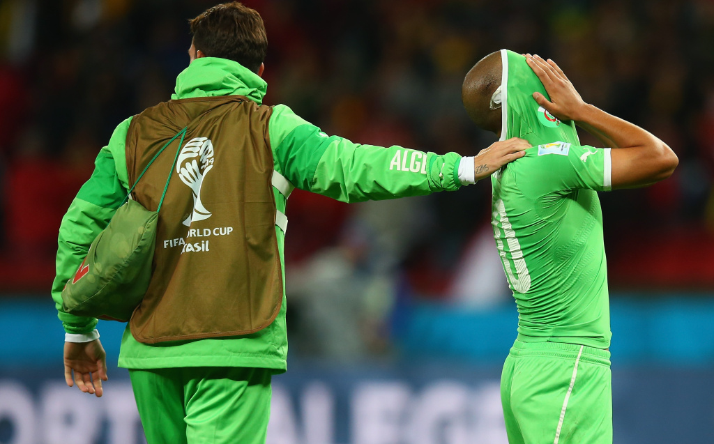 PORTO ALEGRE, BRAZIL - JUNE 30:  Sofiane Feghouli of Algeria (R) reacts after being defeated by Germany 2-1 during the 2014 FIFA World Cup Brazil Round of 16 match between Germany and Algeria at Estadio Beira-Rio on June 30, 2014 in Porto Alegre, Brazil.  (Photo by Julian Finney/Getty Images)
