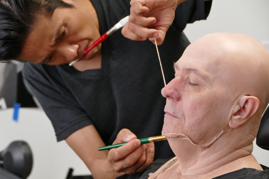 Makeup artist Kazuhiro Tsuji works on Gary Oldman's prosthetics on the set of director Joe Wright's