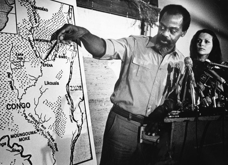 Original caption: Herman Regusters points out Lake Tele region in the Congo where he says he and wife Kia spotted and photographed a dinosaurlike creature on a recent African expedition.