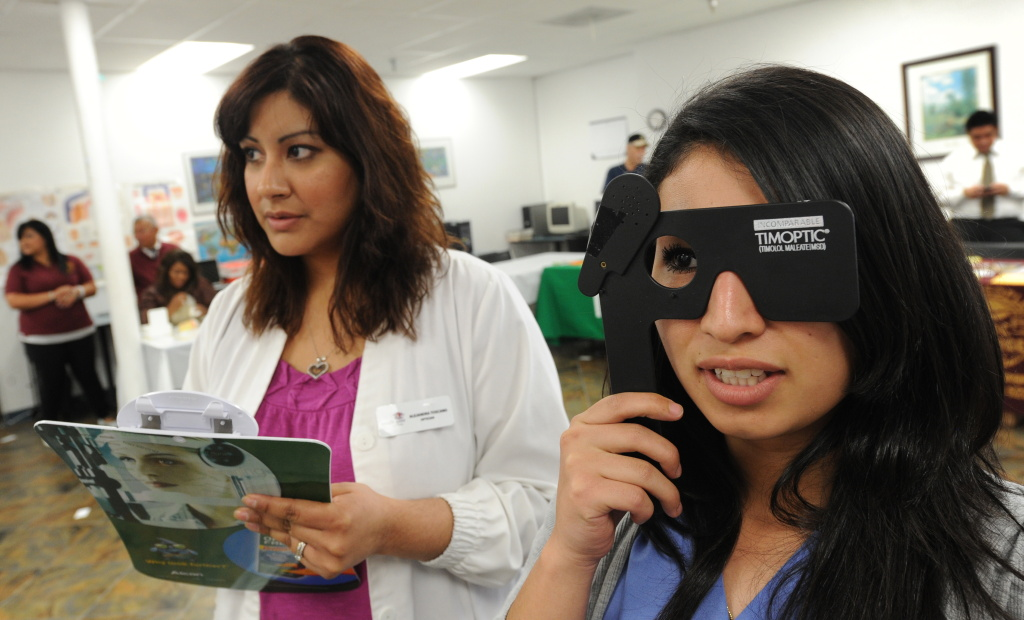 Bianca Garcia gets her eyes tested by Alejandra Toscano from South Gate Optometry during a free clinic.