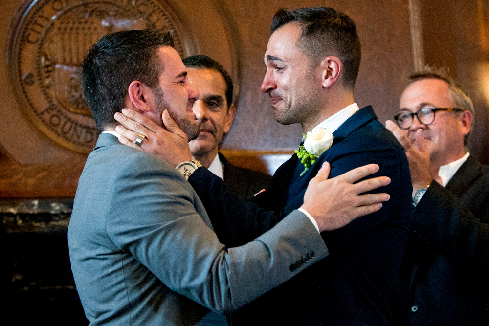 Jeff Zarrillo (L) and Paul Katami (R), plaintiffs in the Supreme Court case that overturned California's same-sex marriage ban, became the first gay couple to wed in Los Angeles since 2008 on Friday at City Hall. Outgoing Mayor Antonio Villaraigosa officiated the ceremony.