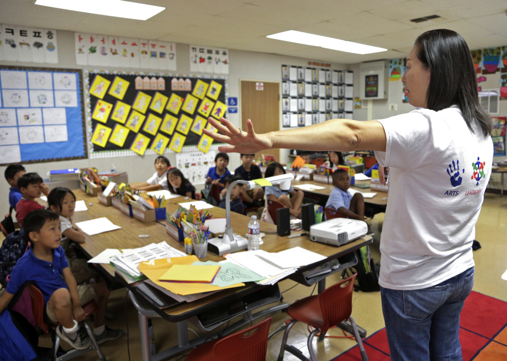 In this Sept. 30, 2016 photo, teacher Regina Yang leads a bilingual Korean-English language immersion class at Porter Ranch Community School in Los Angeles.