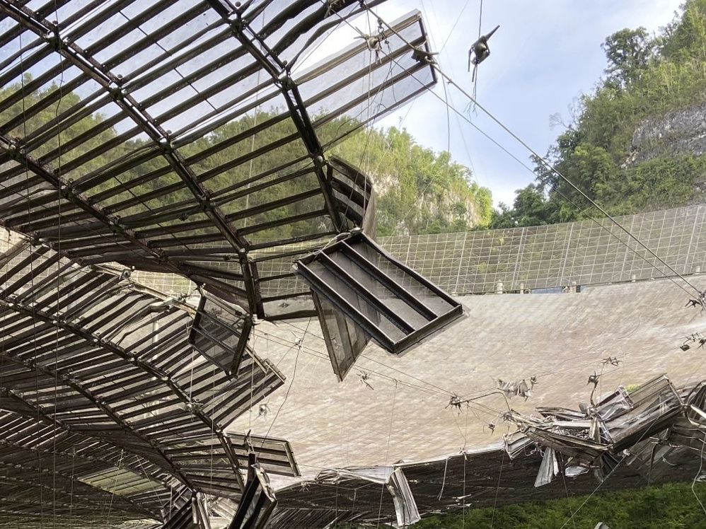 In August a broken cable that supported a metal equipment platform created a 100-foot (30-meter) gash to the Arecibo radio telescope's reflector dish. Giant, aging cables that support the radio telescope are in danger of failing, and the National Science Foundation has announced the telescope will be dismantled.