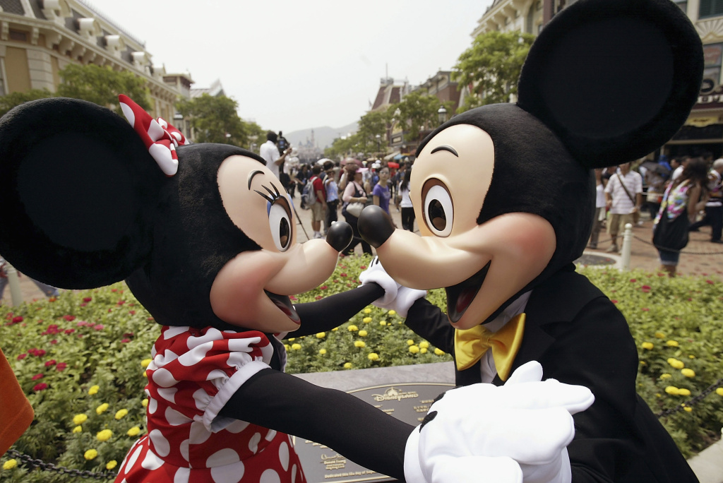 Mickey and Minnie Mouse welcome visitors during the grand opening day of Hong Kong Disneyland September 12, 2005.