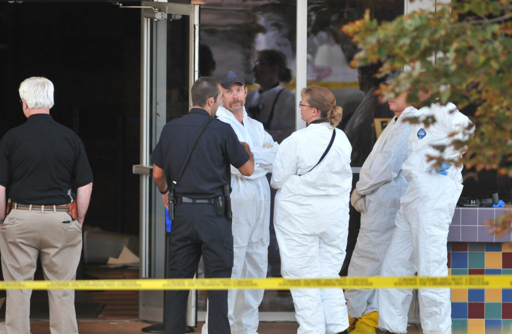 Investigators on the scene at the Century 16 movie theater where a gunmen attacked movie goers during an early morning screening of the new Batman movie,