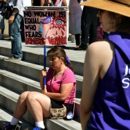 A woman protests against domestic violence as she joins other women's rights advocates in an International Women's Day march in downtown Los Angeles, California on March 8, 2015.