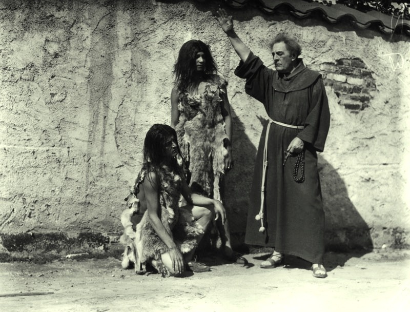 R.D. McLean portraying Junipero Serra in the Mission Play at the Mission Playhouse in San Gabriel in 1926, with two actors portraying Indians.