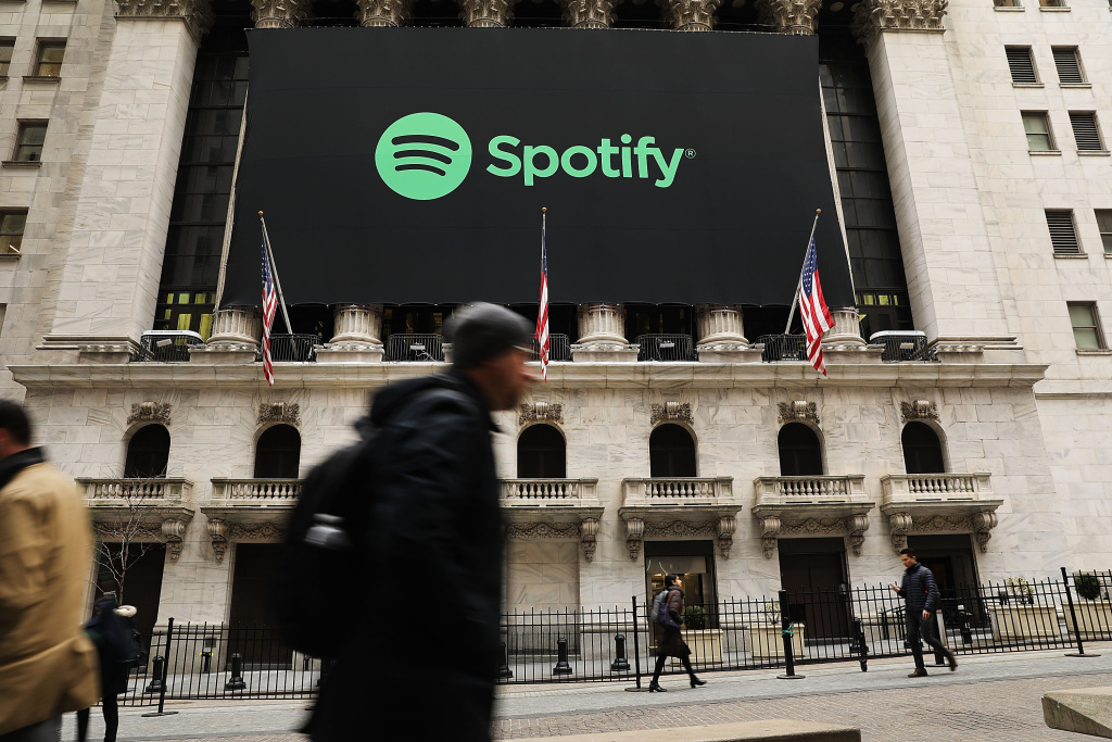 The Spotify banner hangs from the New York Stock Exchange on the morning that the music streaming service begins trading shares at the NYSE on April 3, 2018 in New York City.