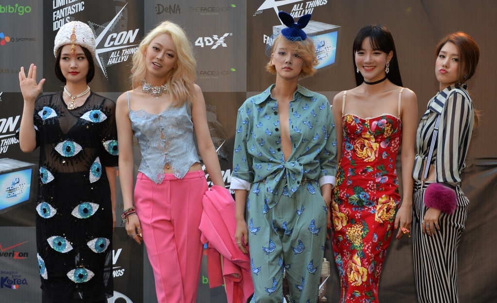 Members of the Korean K-pop group 'SPICA' appear on the red carpet during the K-CON 2014 (Korean Culture Convention) at the Los Angeles Memorial Sports Arena on August 10, 2014.