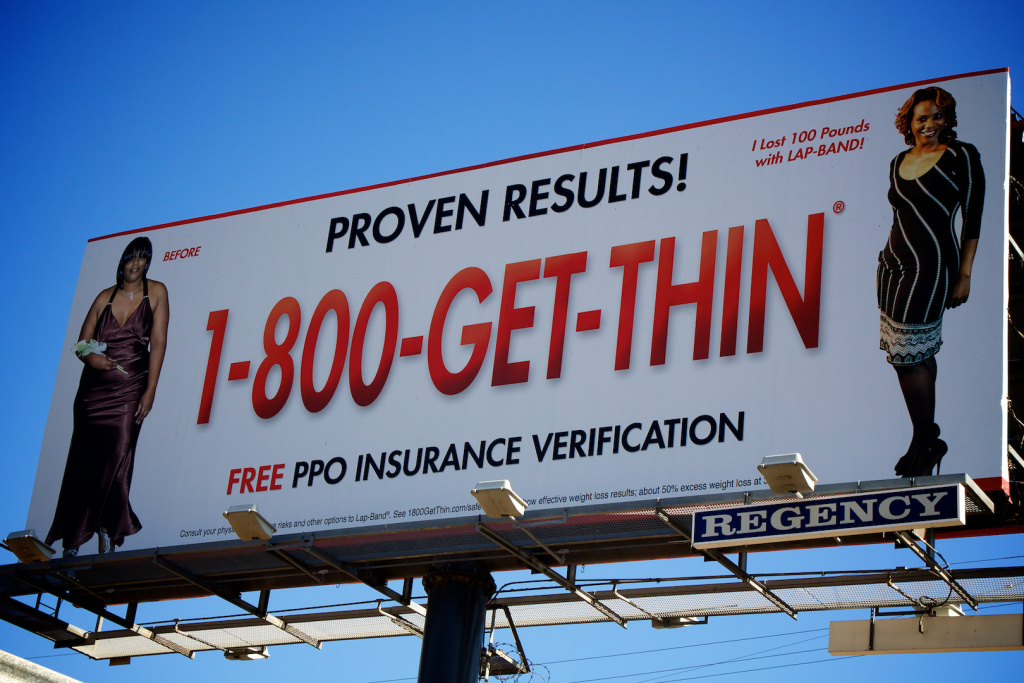 A billboard advertising that the model lost 100 pounds with Lap-Band.