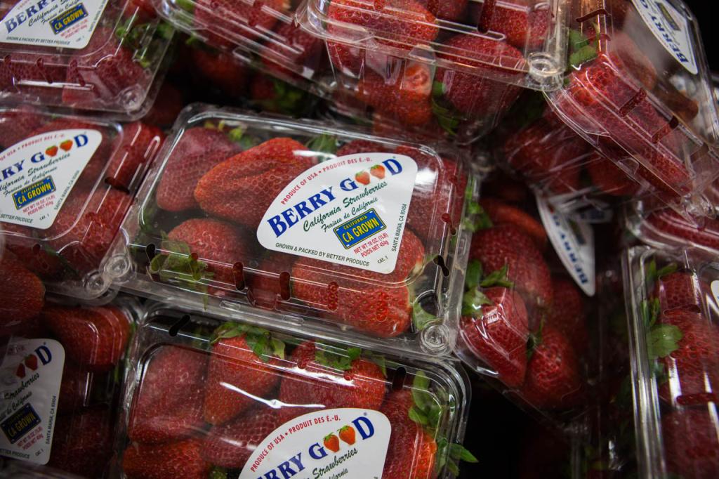 File: Strawberries wend their way to a display at a Walmart Neighborhood Market in Santa Maria.
