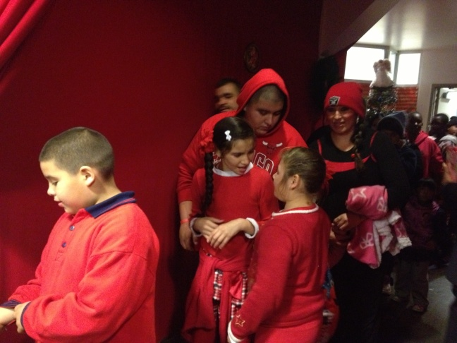 Crystal Taylor poses with her sons, nieces and nephews and sister as they wait in line for the children to get gifts for them from The Midnight Mission's toy drive.