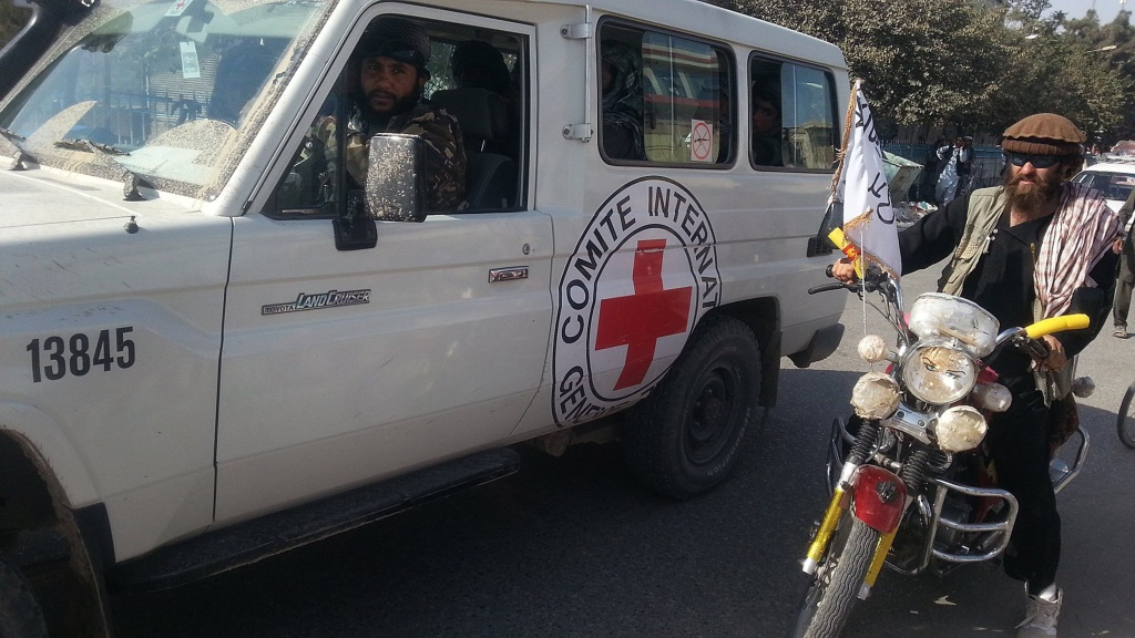 Taliban fighters are seen in an International Commitee of the Red Cross (ICRC) vehicle a day after the insurgents overran the strategic northern city of Kunduz, on September 29, 2015.