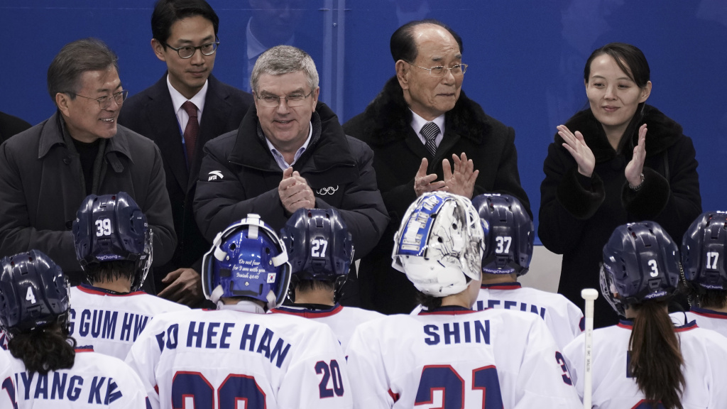 South Korean President Moon Jae-in, IOC president Thomas Bach, North Korea's nominal head of state Kim Yong Nam and Kim Yo Jong greet players from the combined Koreas women's ice hockey team at the 2018 Winter Olympics in Pyeongchang, South Korea.