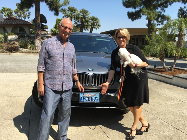 Larry and Janice Hoffmann and their personalized KPCC license plates