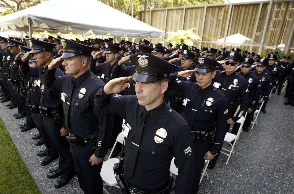 On May 3, 2003, Los Angeles Police Department (LAPD) officers salute during an LAPD ceremony to pay tribute to the 194 Los Angeles officers who have died since 1907.