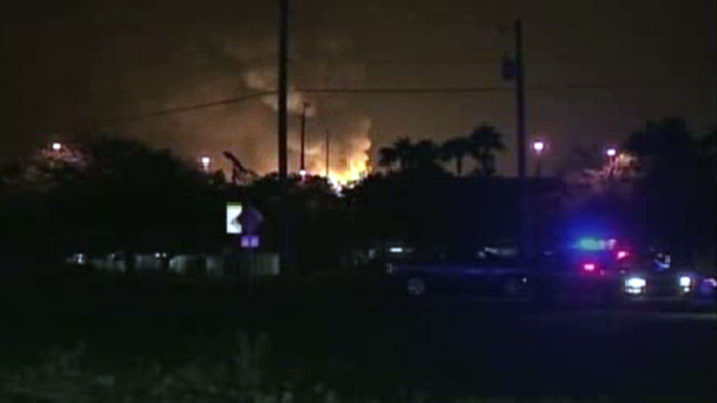 A Blue Rhino propane gas plant burns, as seen in a frame grab from an AP video. The fire sent at least seven workers to the hospital Monday night.