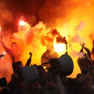 Spartak Moscow soccer fans burn flares and wave a flag with a swastika (lower right) during a game with Shinnik Yaroslavl in Yaroslavl, Russia, on Oct. 30. It's one of several recent violent or racist incidents at sporting events in a country that's hosti