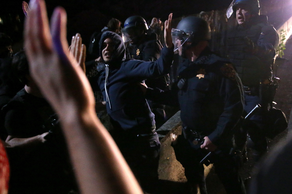 BERKELEY, CA - DECEMBER 08:  California Highway Patrol officers confront protesters who were blocking interstate 80 during a demonstration over recent grand jury decisions in police-involved deaths on December 8, 2014 in Berkeley, California.