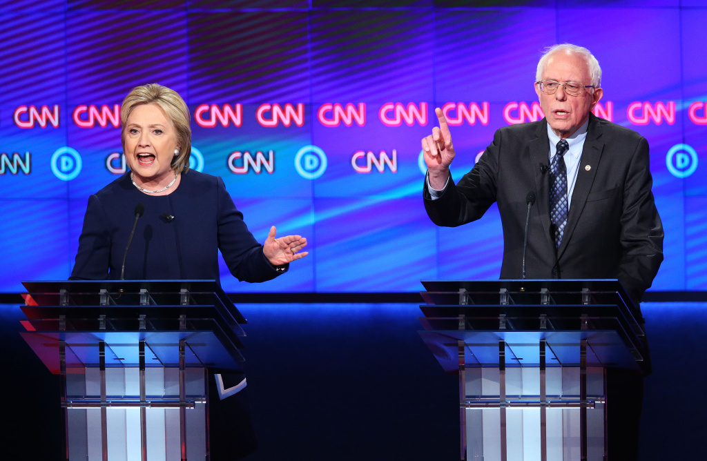 Democratic presidential candidate Senator Bernie Sanders (D-VT) and Democratic presidential candidate Hillary Clinton speak during the CNN Democratic Presidential Primary Debate.