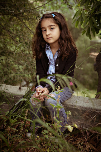 One of 20 portraits by fine arts photographer Greg Cohen of 3- to 10-year-old kids holding replica guns in an expression of frustration over gun laws and the mass shootings in Newtown.