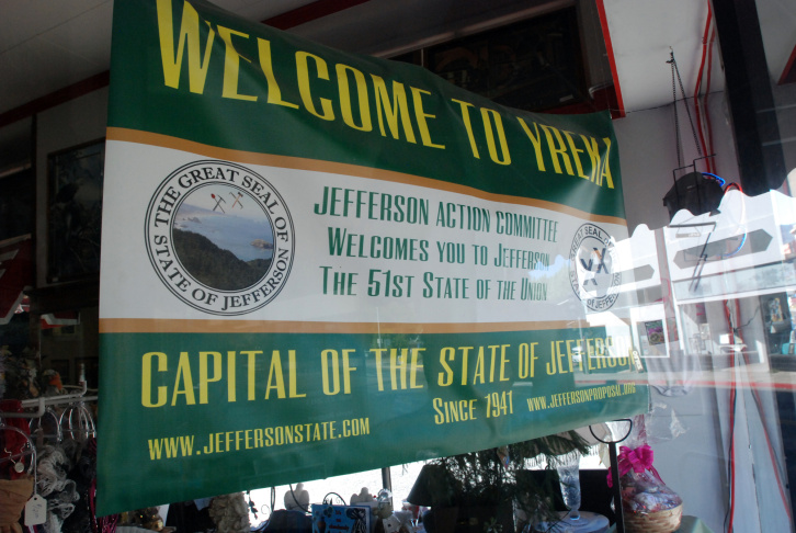 In this Sept. 6, 2013 photo, a banner welcoming visitors to the State of Jefferson hangs in the window of a downtown business in Yreka, Calif. Movements to form a new state with counties from Northern California and Southern Oregon have erupted since 1852, and a new one is brewing among residents who feel the powerful in Sacramento, Calif., ignore the interests of rural people in the northern part of the state.