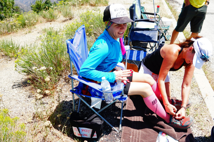 Ultrarunner Martine Sesma is in good spirits as she passes through the Inspiration Point aid station of the Angeles Crest 100 ultramarathon on the Pacific Crest Trail.