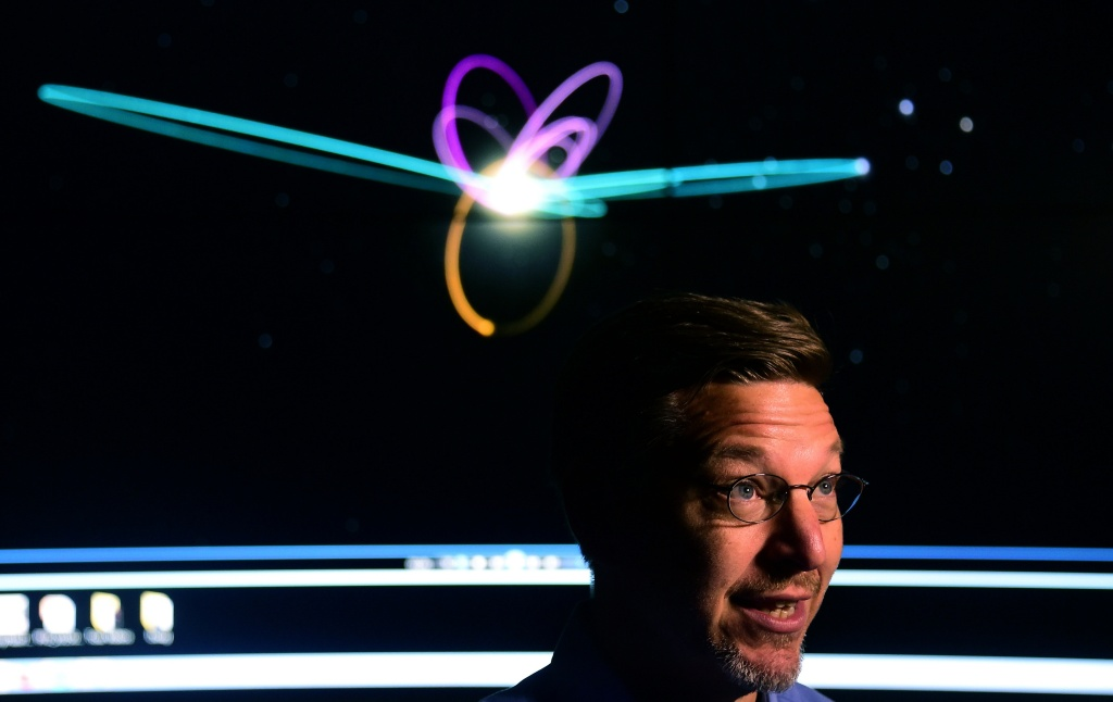 Caltech Astronomer Mike Brown, briefs the media in front of a screen showing the