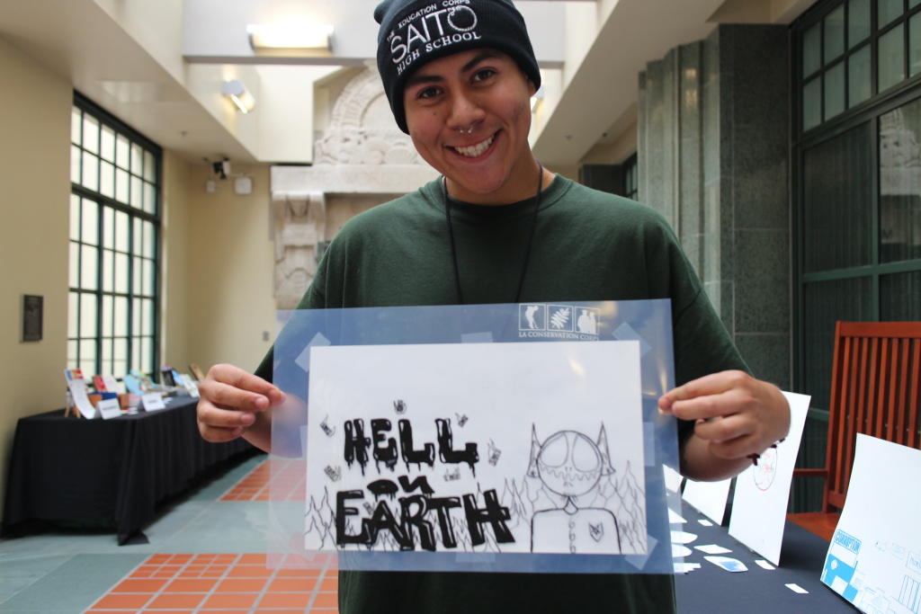 Luis Alfara, 19, shows off his screen print that was on display today at the L.A. Central Library.