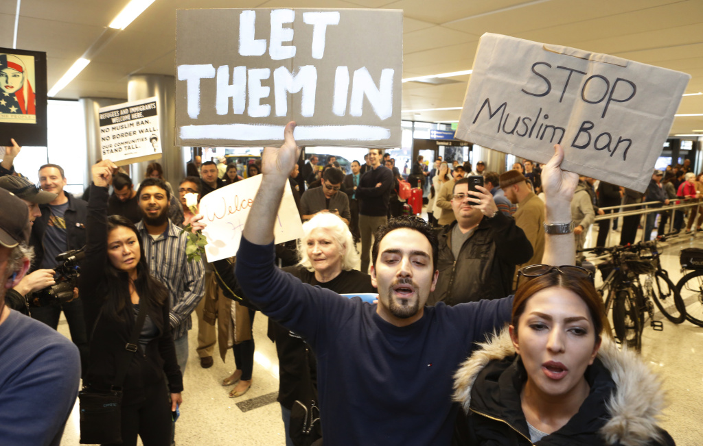 FILE: Supporters demonstrate at Los Angeles International Airport on Thursday, Feb. 2, 2017. A federal court judge in Hawaii on Tuesday blocked the latest travel ban restricting entry of nationals of certain countries, mostly Muslim-majority nations, that the Trump administration views as security risks.