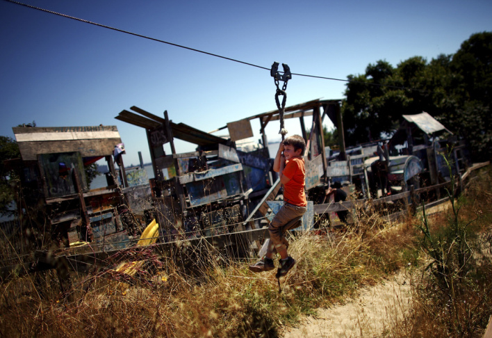 Joseph Straus, 6, rides a zip line at the Berkeley Adventure Playground, where kids can