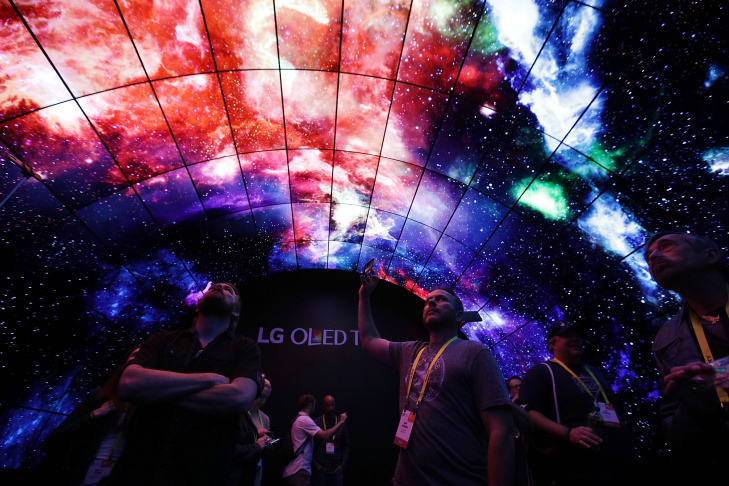 Attendees visit the OLED Tunnel at the LG booth during CES 2017 at the Las Vegas Convention Center.