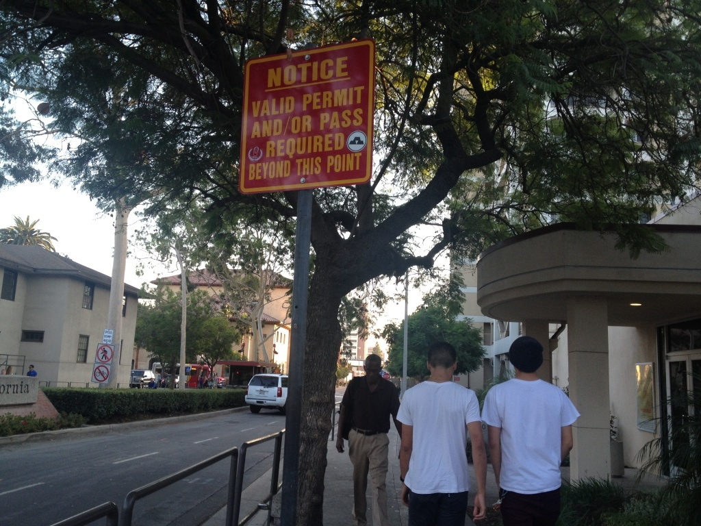 A sign at one of the entrances to the main campus at the University of Southern California warns non-students, staff and faculty that IDs are checked at the campus gate.
