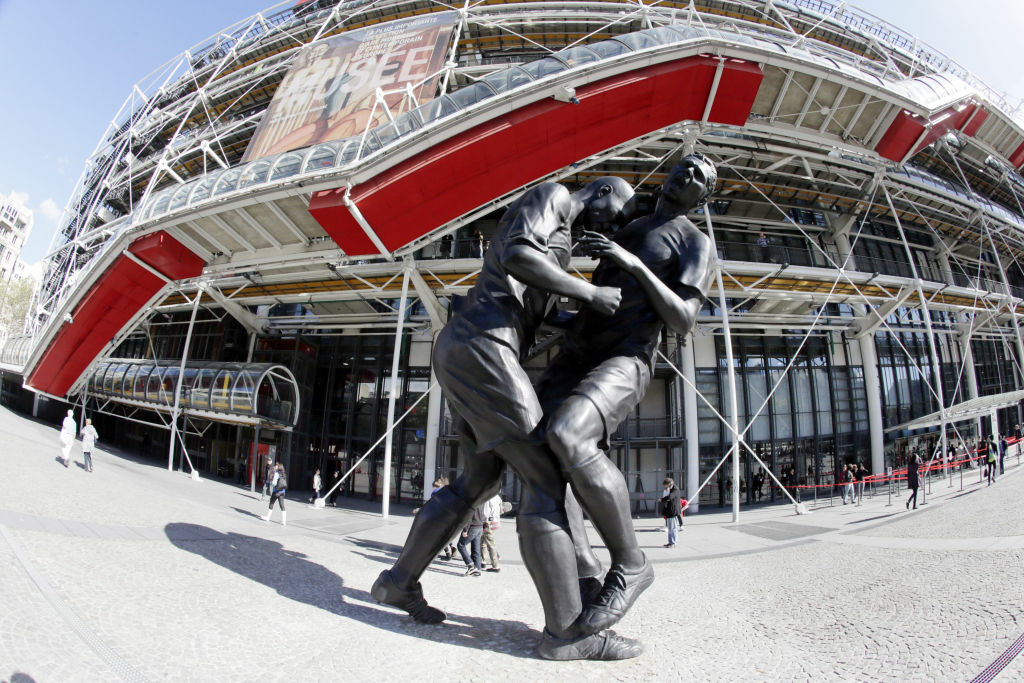A picture taken on September 28, 2012 in Paris shows a bronze sculpture by French Algerian born artist Adel Abdessemed displayed in front of the Centre Pompidou contemporary art center, aka Beaubourg. The sculpture immortalizes the 'headbutt' given by the French former football champion Zinedine Zidane to Italian player Materazzi during the World Cup final in 2006. The Centre Pompidou will dedicate a retrospective to Abdessemed from October 3, 2012 to January 7, 2013.