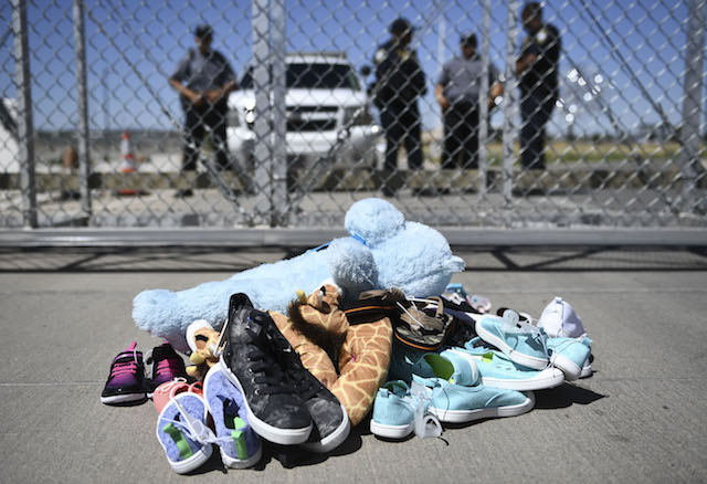 Shoes are left by people at the Tornillo Port of Entry near El Paso, Texas, June 21, 2018, during a protest rally by several American mayors against the U.S. administration's family separation policy.