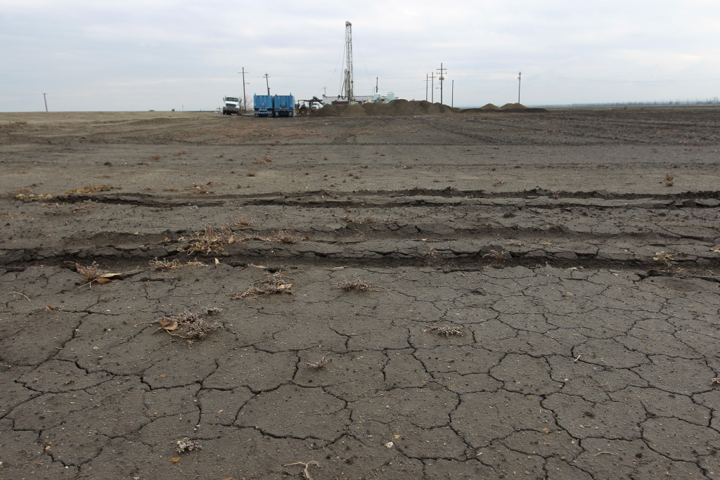 File: Workers drill for water for a farmer on Feb. 6, 2014 near Bakersfield.