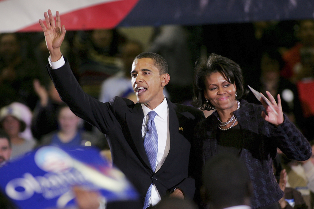 U.S. President Barack Obama and First Lady Michelle wave to a crowd February 10, 2007, back when he first announced that he would seek the Democratic nomination for presidency. In a new book,