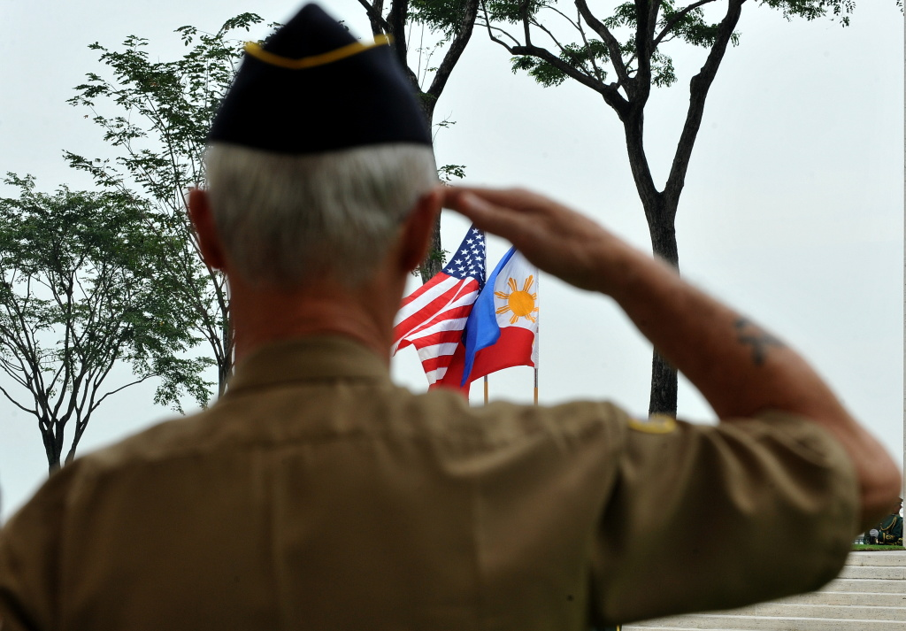 A retired American soldier salutes to the colors during Veterans Day celebration at the American Cemetery in Manila on November 11, 2010. The US pays tribute on Veterans Day to the men and women who have worn the uniform of the United State Armed Forces.  AFP PHOTO / JAY DIRECTO (Photo credit should read JAY DIRECTO/AFP/Getty Images)