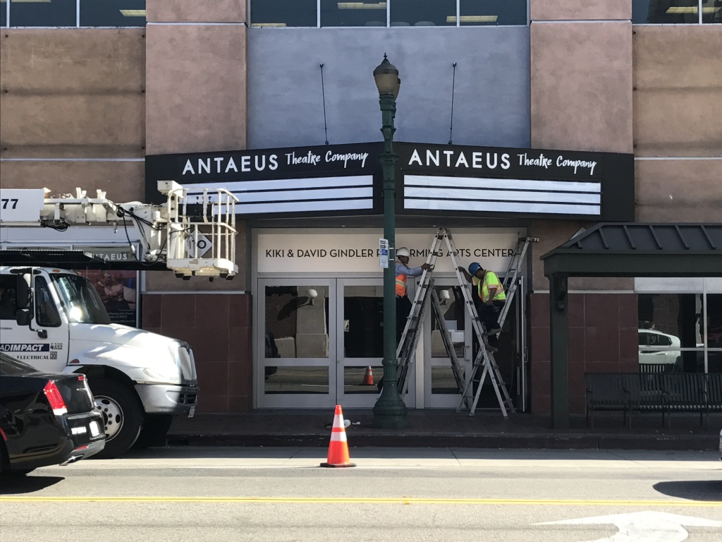 Workers putting the final touches on Antaeus Theatre's marquee.