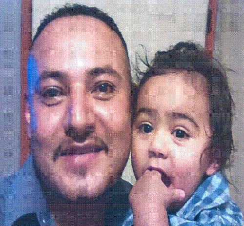 Giovanny Santiago, pictured with son Jayden, is wanted by police for attempted murder and kidnapping.