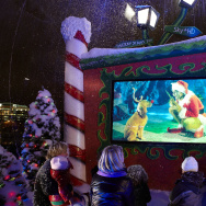 People gather for a festive high definition screening of The Grinch in a giant snow globe on the South Bank on December 14, 2009 in London, England.