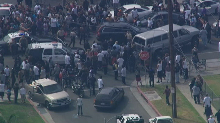 A crowd mobs the scene as a high-speed chase following a bank robbery ends in South L.A.