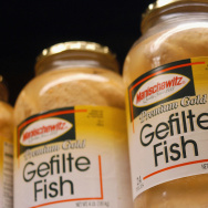 Jars of gefilte fish sit on the shelves at a market in Yardley, Pa.