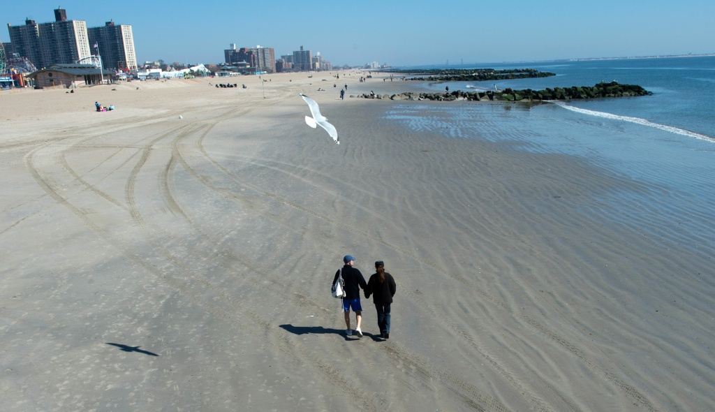 A couple walks the beach at Coney Island on March 9, 2016 in New York.
